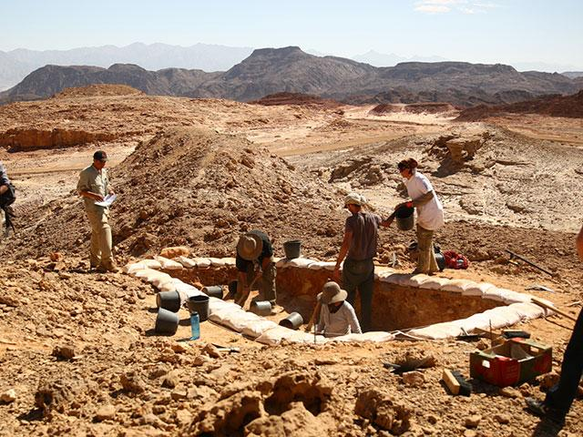 "(Courtesy of E. Ben-Yosef and the Central Timna Valley Project): ""Excavations of ancient copper mines as part of Tel Aviv University's Central Timna Valley Project. Copper production technologies and the organization of the industry reflect the society re"