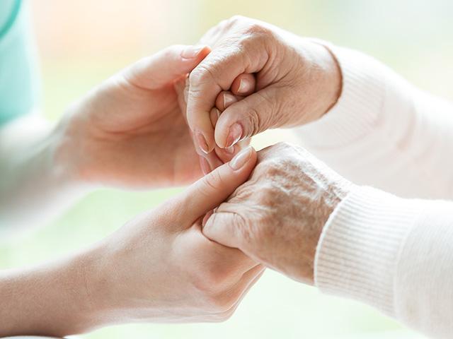 elderly-hands-holding_si.jpg