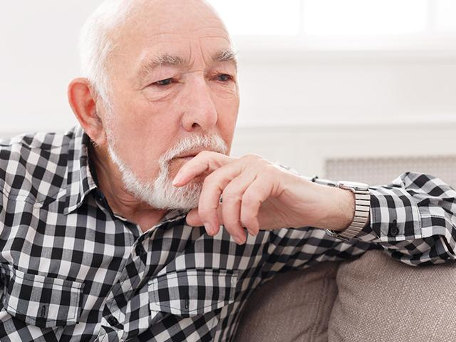 pensive elderly man