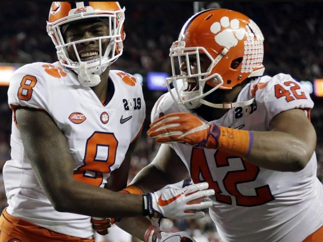 Clemson's Justyn Ross celebrates his touchdown catch with Christian Wilkins (42) during the second half of the NCAA college football playoff championship game against Alabama Monday night. AP Photo.