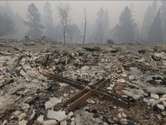 A cross is among the rubble of the Our Savior Lutheran Church Friday, Nov. 9, 2018, in Paradise, Calif. The church was destroyed by a wildfire that swept through the area Thursday. AP Photo.