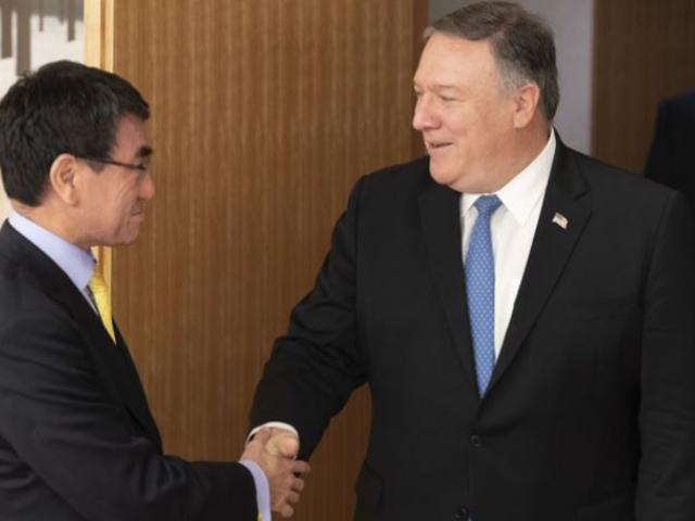 US Secretary of State Mike Pompeo, center, shakes hands with Japan's Foreign Minister Taro Kono before a meeting Saturday.