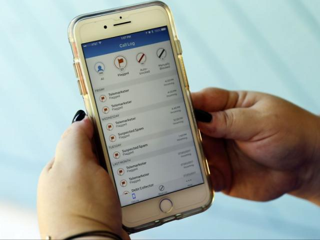 This Aug. 1, 2017, file photo, shows a call log displayed via an AT&T app on a cellphone in Orlando, Fla. New tools are coming to help fight robocall scams, but don't expect unwanted calls to disappear. (AP Photo/John Raoux, File)