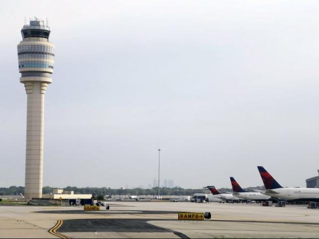 Air traffic control tower at at Hartsfield–Jackson Atlanta International Airport in Atlanta. AP Photo.