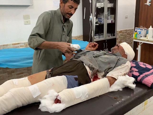 A doctor treats a patient wounded in a Turkish military drone strike in Tal Tamr, Syria. (Image credit: CBN News)
