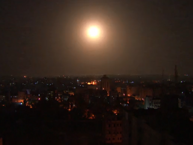 AP: Image of rocket being intercepted by Iron Dome over Gaza skyline