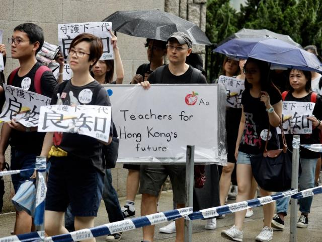 Pro-democracy protesters march organized by teachers in Hong Kong Saturday, Aug. 17, 2019 (AP Photo/Vincent Yu)