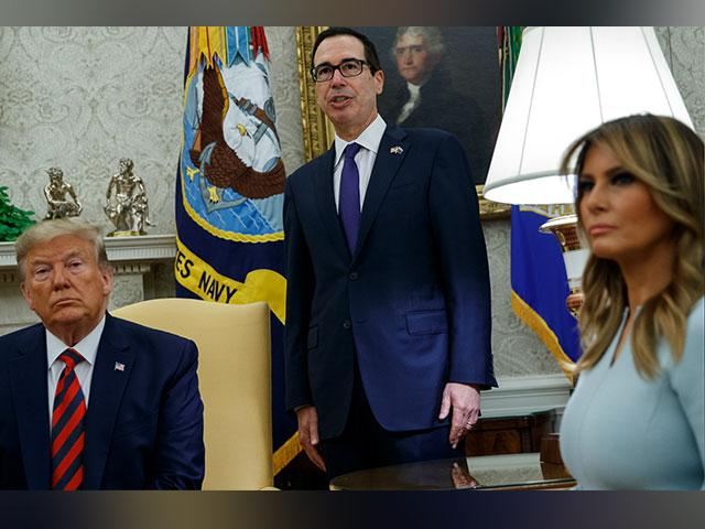 President Donald Trump and first lady Melania Trump listen as Treasury Secretary Steve Mnuchin announces sanctions on Iran in the Oval Office of the White House, Friday, Sept. 20, 2019. (AP Photo)