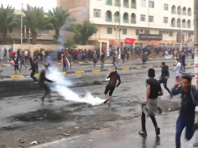 AP: Protesters running and kicking away teargas canisters in the city of Najaf. 1 December 2019