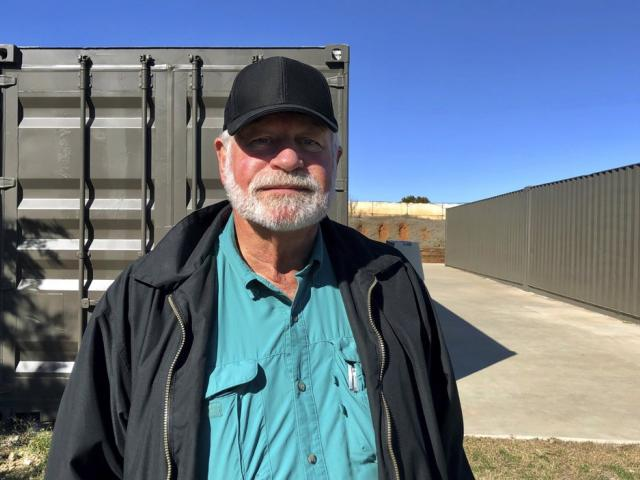 Jack Wilson, 71, poses for a photo at a firing range outside his home in Granbury, Texas, Monday, Dec. 30, 2019. (AP Photo/Jake Bleiberg)