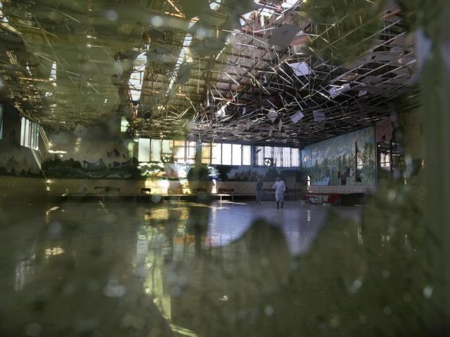 Damage of the Dubai City wedding hall is seen after an explosion in Kabul, Afghanistan, Sunday, Aug. 18, 2019 (AP Photo/Rafiq Maqbool)