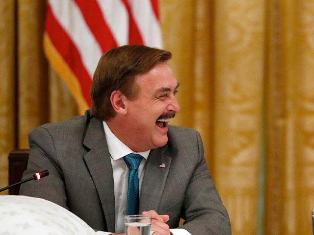 """Michael Lindell, with My Pillow, laughs with President Donald Trump during a """"Made in America,"""" roundtable event in the East Room of the White House in Washington, Wednesday, July 19, 2017. (AP Photo/Alex Brandon)"""