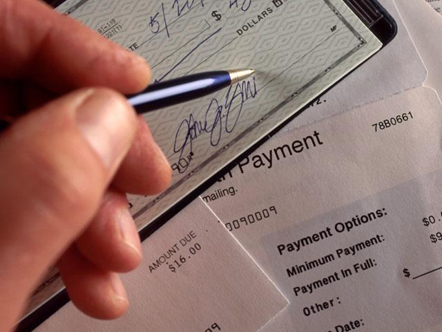 paying-bill-tithe_si.jpg