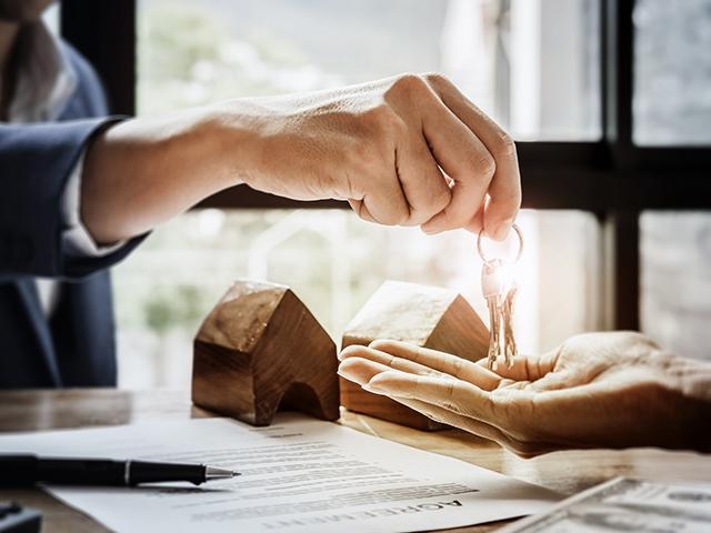 house keys being placed in hand of new owner