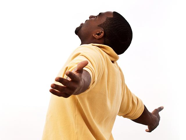 man worshipping god with his arms wide open