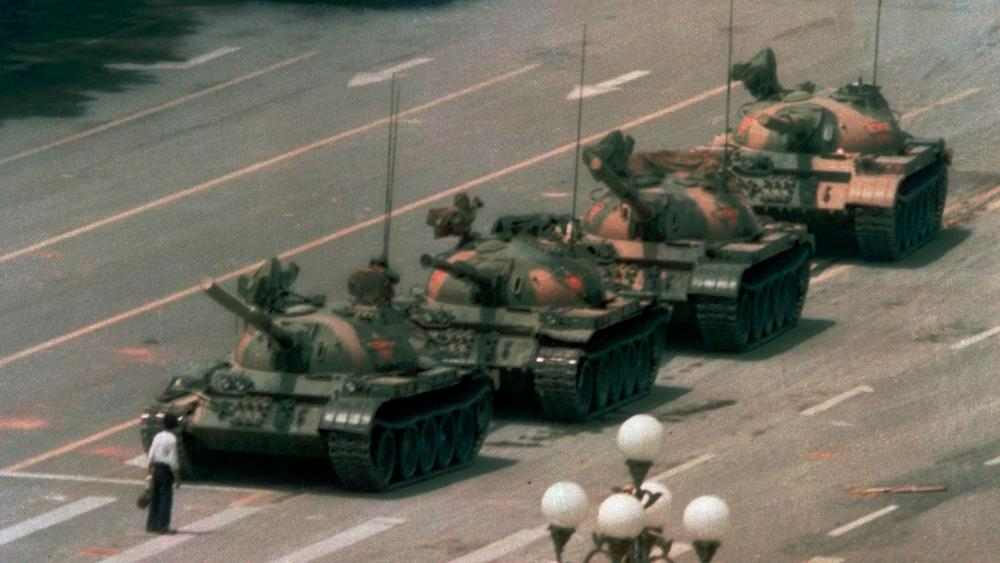 In this June 5, 1989 file photo, a Chinese man stands alone to block a line of tanks heading east on Beijing's Changan Blvd. in Tiananmen Square. (AP Photo/Jeff Widener, File)