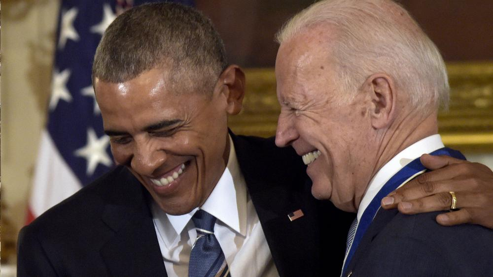 Joe Biden's new campaign ad touts his ties to President Obama (AP Photo)