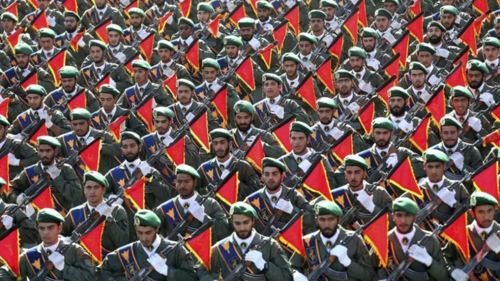 In this Sept. 21, 2016 file photo, Iran's Revolutionary Guard troops march in a military parade marking the 36th anniversary of Iraq's 1980 invasion of Iran. (AP Photo/Ebrahim Noroozi, File)
