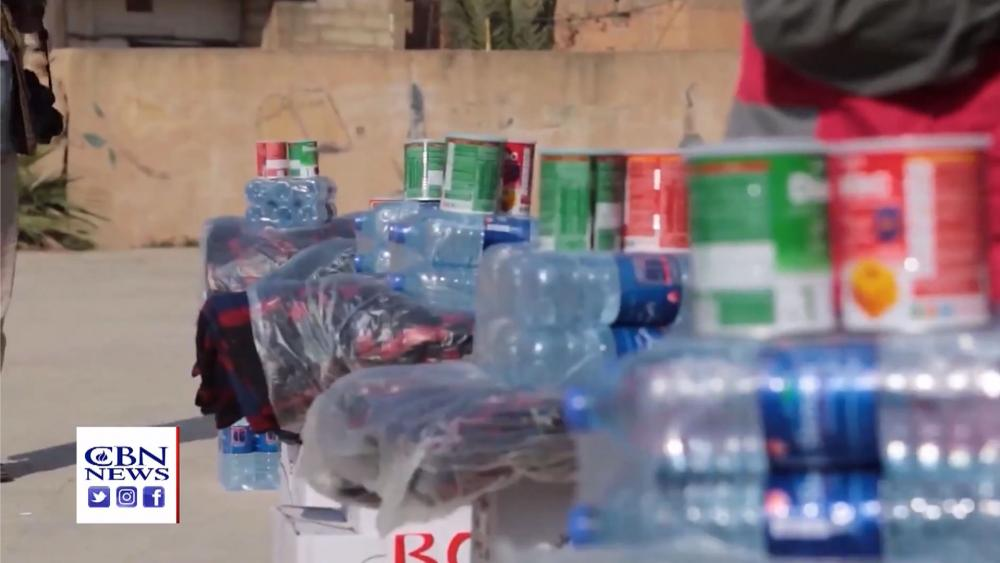 Bottled water is just part of the food and other supplies CBN's Operation Blessing is bringing to Syrian refugees. (Image credit: CBN News)