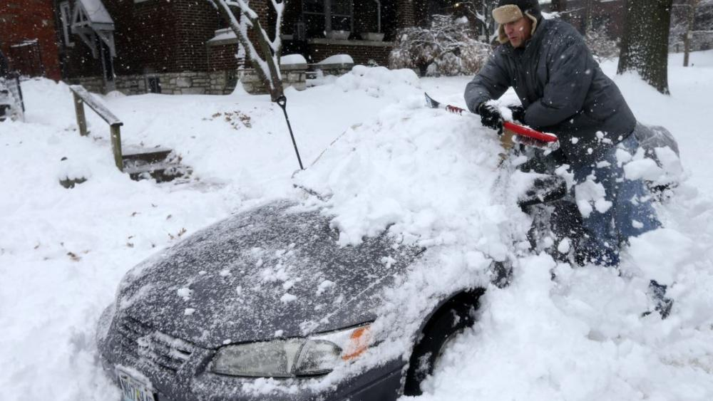 Jeff Clifford digs out his girlfriend's car from a pile of snow on Saturday, Jan. 12, 2019, in St. Louis. AP Photo.