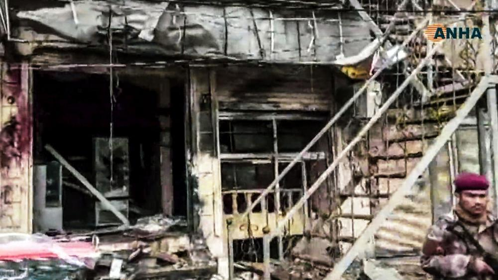 This frame grab from video provided by Hawar News, ANHA, the news agency for the semi-autonomous Kurdish areas in Syria, shows a damaged restaurant where an explosion occurred, in Manbij, Syria, Wednesday, Jan. 16, 2019. Image credit: ANHA via AP.