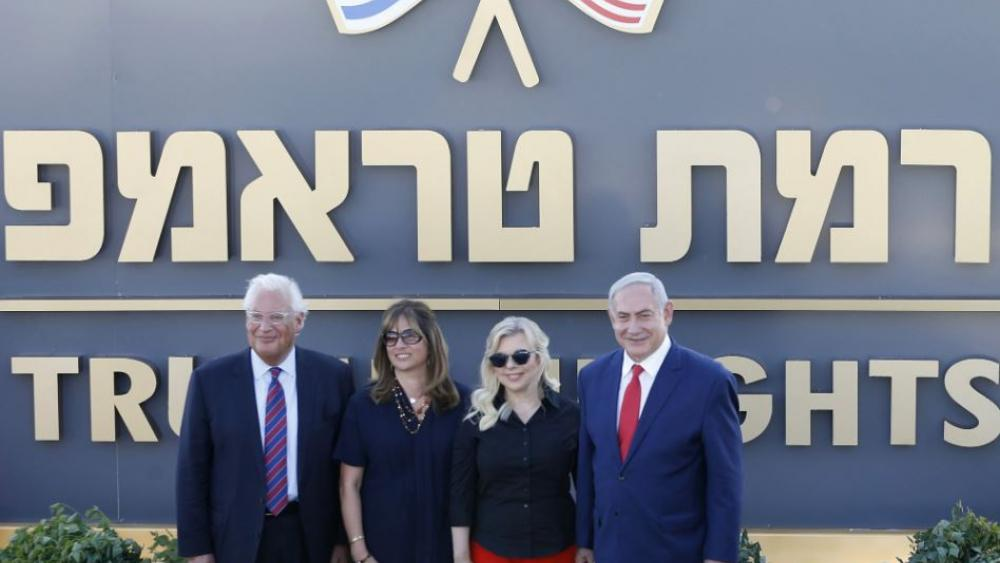Israeli Prime Minister Benjamin Netanyahu, right, his wife Sara , United States Ambassador to Israel David Friedman, left, his wife Tammy pose during the inauguration of a new settlement named after President Donald Trump in the Golan Heights.